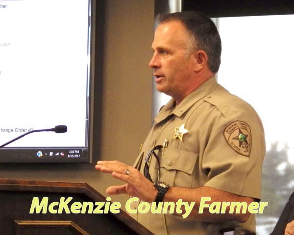 Sheriff extends hand on return to county meeting